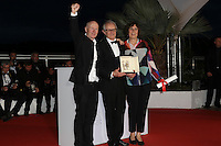 Maria Dragus Romanian director Cristian Mungiu (R) and French director Olivier Assayas talk on stage wafter being awarded with the Best Director prize, respectively for the film 'Graduation (Bacalaureat)' and 'Personal Shopper' during the closing ceremony of the annual 69th Cannes Film Festival at Palais des Festivals on May 22, 2016 in Cannes, France.