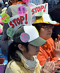 """May 1, 2013, Tokyo, Japan - Carrying hand-made signs bearing such words as """"Stop"""" and """"No,"""" unionists participate in a May Day rally sponsored by the National Confederation of Trade Unions at a Tokyo park on Wednesday, May 1, 2013. Some 32,000 people took part in the rally, voicing their concerns for tax hike and constitutional revision among other things.  (Photo by Natsuki Sakai/AFLO)"""