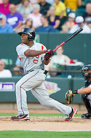 Bryson Myles (23) of the Carolina Mudcats follows through on his swing against the Winston-Salem Dash at BB&T Ballpark on July 25, 2013 in Winston-Salem, North Carolina.  The Mudcats defeated the Dash 5-4.  (Brian Westerholt/Four Seam Images)