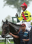 Silver Max and Robby Albarado win the Shadwell Turf Mile at Keeneland Race Course.   October 05, 2013.