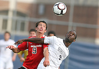Uche Oteqbeye #9 of Georgetown University battles for a high ball with Ryan Burnham #9 of Northeastern University during an NCAA match at North Kehoe Field, Georgetown University on September 3 2010 in Washington D.C. Georgetown won 2-1 AET.