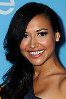 "13 July 2020 - Naya Rivera, the actress best known for playing cheerleader Santana Lopez on Glee, has been confirmed dead. Rivera, 33, is believed to have drowned while swimming in the lake with her 4-year-old son, who was found asleep on their rental pontoon boat after it was overdue for return. 7 September 2010 - Los Angeles, California - Naya Rivera. ""Glee"" Season Two Premiere and DVD Release Party held at Paramount Studios. Photo Credit: Byron Purvis/AdMedia"