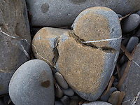 Italy. Liguria Region. Ospedaletti.  A stone with a heart's shape on the beach. 26.12.16  © 2016 Didier Ruef