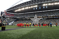 SEATTLE, WA - NOVEMBER 10: The referees and starting players for both teams march onto the field during a game between Toronto FC and Seattle Sounders FC at CenturyLink Field on November 10, 2019 in Seattle, Washington.