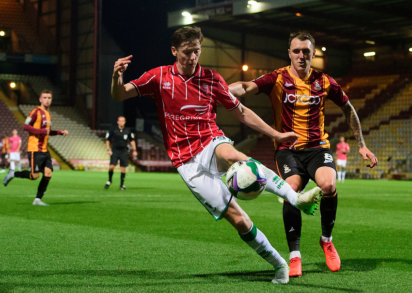 Lincoln City's Conor McGrandles vies for possession with Bradford City's Callum Cooke<br /> <br /> Photographer Chris Vaughan/CameraSport<br /> <br /> Carabao Cup Second Round Northern Section - Bradford City v Lincoln City - Tuesday 15th September 2020 - Valley Parade - Bradford<br />  <br /> World Copyright © 2020 CameraSport. All rights reserved. 43 Linden Ave. Countesthorpe. Leicester. England. LE8 5PG - Tel: +44 (0) 116 277 4147 - admin@camerasport.com - www.camerasport.com