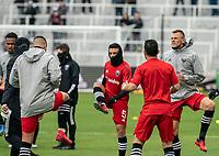 Junior Moreno #5 and Frédéric Brillant #13 of DC United warm up