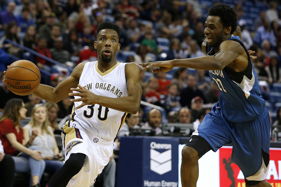 New Orleans Pelicans guard Norris Cole (30) drives against Minnesota Timberwolves guard Andrew Wiggins (22) during the first half of an NBA basketball game Saturday, Feb. 27, 2016, in New Orleans. (AP Photo/Jonathan Bachman)