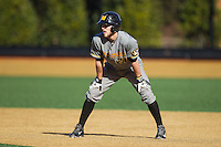 Jake Ivory (21) of the Missouri Tigers takes his lead off of first base against the Radford Highlanders at Wake Forest Baseball Park on February 21, 2014 in Winston-Salem, North Carolina.  The Tigers defeated the Highlanders 15-3.  (Brian Westerholt/Four Seam Images)