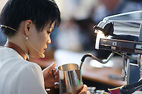 MELBOURNE, 13 April 2014 - Jibi Little from NSW competing in the AASCA Australian Latte Art Championship held at 16 River Street, Richmond, Victoria. Photo Sydney Low.