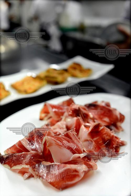 Wafers of Jamon Iberico in Antonio Saez's Lasarte Restaurant on Mallorca Street. /Felix Features