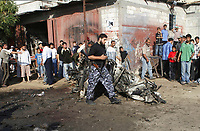 """Palestinians inspect a destroyed vehicle after an Israeli air strike in the southern Gaza strip June 30, 2007. An Israeli aircraft fired at a vehicle in the Gaza Strip on Saturday, killing two militants, a rescue worker and Hamas security source said.""""photo by Fady Adwan"""""""