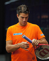 07-02-12, Netherlands,Tennis, Den Bosch, Daviscup Netherlands-Finland, Training, Jesse Huta Galung werkt aan zijn racket