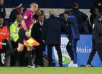 West Bromwich Albion manager Tony Pulis puts his arm around Swansea City head coach Bob Bradley after the final whistle of the Premier League match between West Bromwich Albion and Swansea City at The Hawthorns, England, UK. Wednesday 14 December 2016