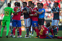 Orlando, Florida - Saturday, June 04, 2016: Tempers flare with Paraguayan forward Dario Lezcano (19) and Costa Rican defender Johnny Acosta (2) exchanging words during a Group A Copa America Centenario match between Costa Rica and Paraguay at Camping World Stadium.