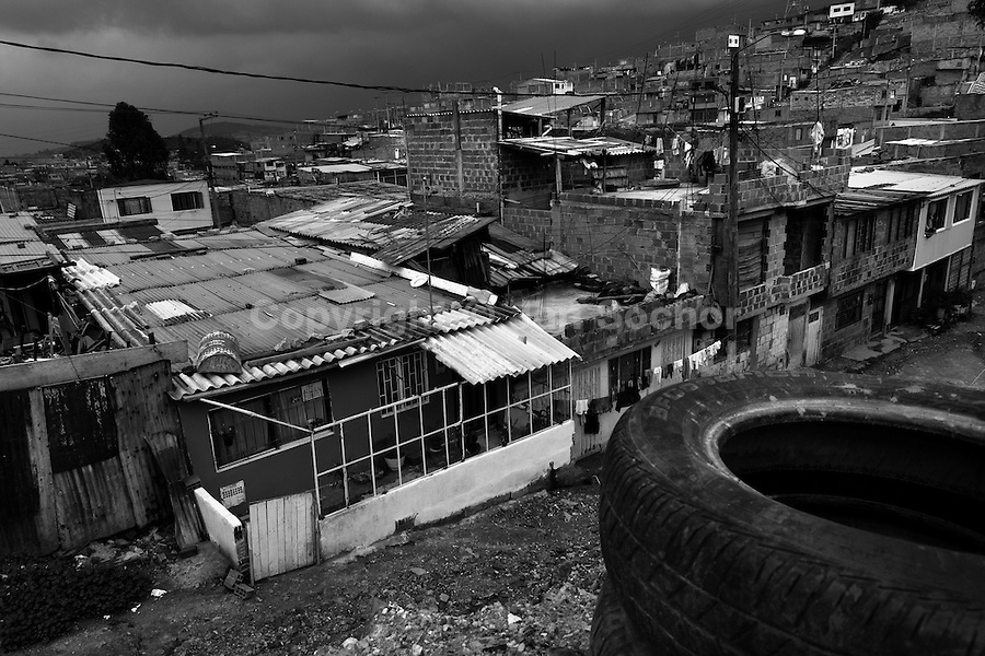 Ciudad Bolívar, a shanty town in the south of Bogota, where internally displaced people from all over the country live, Colombia, 24 May 2009. With nearly fifty years of armed conflict, Colombia has the highest number of civil war refugees in the world. During the last ten years of the civil war more than 3 million people have been forced to abandon their lands and to leave their homes due to the violence. Internally displaced people (IDPs) come from remote rural areas, where most of the clashes between leftist guerrillas FARC-ELN, right-wing paramilitary groups and government forces takes place. Displaced persons flee in a hurry, carrying just personal belongings, and thus they inevitably end up in large slums of the big cities, with no hope for the future.