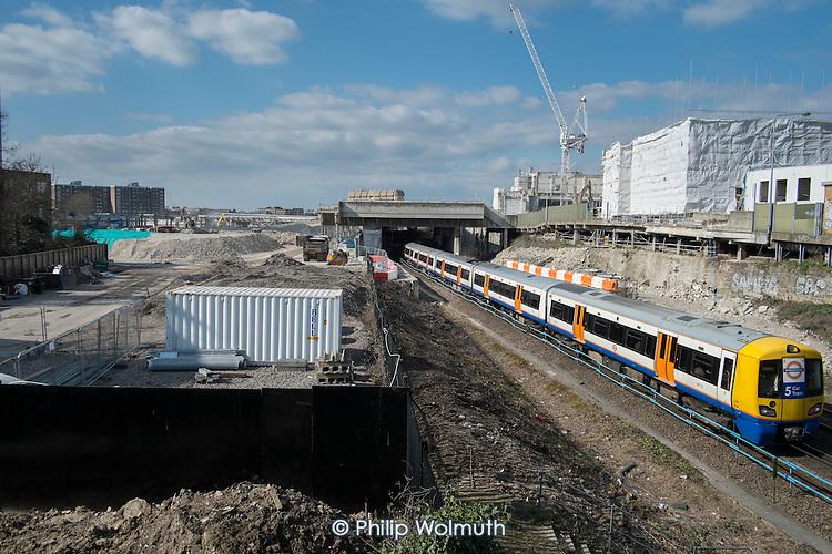 Overground train and Earls Court development site, London.