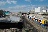 Overground train and Earls Court development site, London.