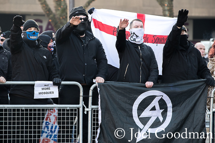 "© Joel Goodman - 07973 332324 . FILE PICTURE DATED 26/11/2016 of National Action supporters performing a Nazi salute at an anti mosque demonstration in Bolton , UK , as today, 12th December 2016 , the British Government have laid out an order in Parliament to use anti terrorism legislation to ban the Neo-Nazi group "" National Action "" . Approximately 100 people attend a demonstration against the construction of mosques in Bolton , under the banner "" No More Mosques "" , organised by a coalition of far-right organisations . Photo credit : Joel Goodman"