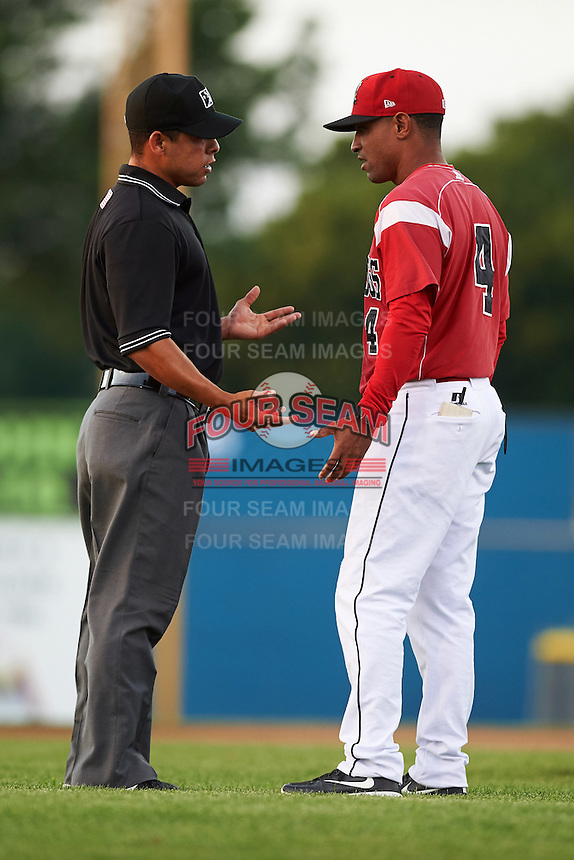 Batavia Muckdogs manager Angel Espada (4) argues a call with umpire Jhonatan Biarreta during a game against the Aberdeen Ironbirds on July 14, 2016 at Dwyer Stadium in Batavia, New York.  Aberdeen defeated Batavia 8-2. (Mike Janes/Four Seam Images)