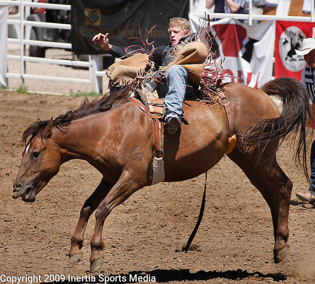 BELLE FOURCHE, SD - JUNE 28, 2009 :  Chet Smith of Rapid City hangs on in the bareback riding event at the 2009 South Dakota High School Rodeo Finals Sunday in Belle Fourche. (Photo by Dick Carlson/Inertia)