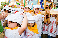 """Everyone shoulders some of the load at the """"Dancing of the Children's Giglio"""" on July 7, 2006."""