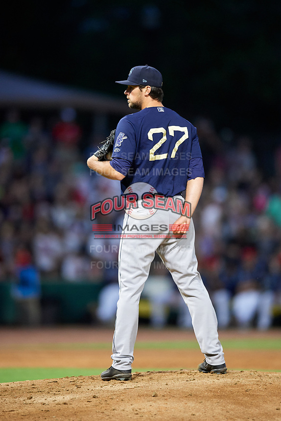 Mobile BayBears relief pitcher Jake Jewell (27) gets ready to deliver a pitch during a game against the Jacksonville Jumbo Shrimp on April 14, 2018 at Baseball Grounds of Jacksonville in Jacksonville, Florida.  Mobile defeated Jacksonville 13-3.  (Mike Janes/Four Seam Images)