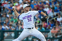 Logan Shore (32) of the Florida Gators pitches during a game between the Miami Hurricanes and Florida Gators at TD Ameritrade Park on June 13, 2015 in Omaha, Nebraska. (Brace Hemmelgarn/Four Seam Images)