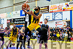 Keane's Supervalu Killorglin C.Y.M.S. player Rami Gahanem sails towards the basket under close attention from Dublin Lions' Tiernan Howe as Lions' Finn Hughes watches on helplessly and Keanes' Pranas Skurdauskas anticipates the rebound.