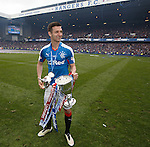 Jason Holt with the league trophy as he drops the lid