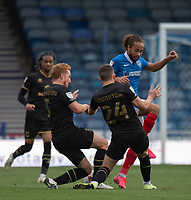 Portsmouth's Marcus Harness (right) battles for possession with Milton Keynes Dons' Dean Lewington (left) and Jordan Houghton (centre)<br /> <br /> Photographer David Horton/CameraSport<br /> <br /> The EFL Sky Bet League One - Portsmouth v Milton Keynes Dons - Saturday 10th October 2020 - Fratton Park - Portsmouth<br /> <br /> World Copyright © 2020 CameraSport. All rights reserved. 43 Linden Ave. Countesthorpe. Leicester. England. LE8 5PG - Tel: +44 (0) 116 277 4147 - admin@camerasport.com - www.camerasport.com