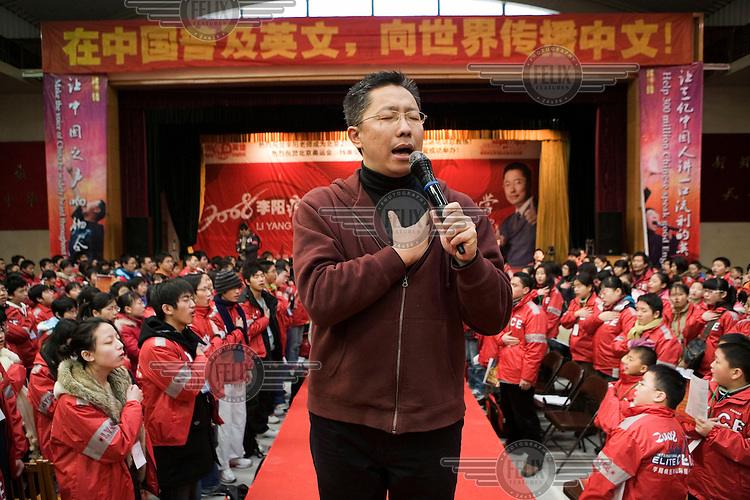 """Li Yang leads students to make pledges to themselves about studying English. He has become China's Elvis of English, perhaps the world's only language teacher known to bring students to tears of excitement. He has built an empire out of his country's deepening devotion to a language it once derided as the tongue of barbarians and capitalists. His philosophy, captured by one of his many slogans, is flamboyantly patriotic: """"Conquer English to Make China Stronger!"""""""