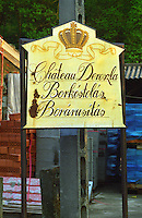 """The Chateau Dereszla winery: a rusting sign post with a crown to the winery (""""Borkostolas, Borarusitas). Dereszla is owned by Edonia, a French (Bordeaux) négociant (wine trading) company. Major renovations are being done. Credit Per Karlsson BKWine.com"""