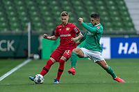 18th May 2020, WESERSTADION, Bremen, Germany; Bundesliga football, Werder Bremen versus Bayer Leverkusen;  Mitchell Weiser Leverkusen is challenged by Milot Rashica Werder Bremen