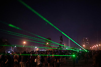 Rioters face police in the streets of dowtown  demanding the resignation of President Sebastian Piñera. Protest erupted in Chile October 18th after a rise in the price of transportation. Green lasers are used by rioters to blind police forces.