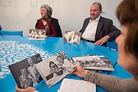 """Ausstellung """"Dialog mit der Zeit"""" im Museum fuer Kommunikation in Berlin-Mitte.<br /> Vom 1. April bis 23. August 2015 werden in der Ausstellung die Facetten des Alters und der Alterns erlebbar gemacht.<br /> Bundespraesident Joachim Gauck eroeffnete die Ausstellung am 31. Maerz 2015 mit einem Rundgang und einer Rede zu neuen Altersbildern in einer Gesellschaft des laengeren Lebens.<br /> Im Bild: Ausstellungsbesucher werden verschiedene Fotos von aelteren Menschen zum Thema Alter gezeigt und sie sollen sich eines aussuchen, zu dem sie spontan eine Beziehung aufbauen koennen.<br /> 31.3.2015, Berlin<br /> Copyright: Christian-Ditsch.de<br /> [Inhaltsveraendernde Manipulation des Fotos nur nach ausdruecklicher Genehmigung des Fotografen. Vereinbarungen ueber Abtretung von Persoenlichkeitsrechten/Model Release der abgebildeten Person/Personen liegen nicht vor. NO MODEL RELEASE! Nur fuer Redaktionelle Zwecke. Don't publish without copyright Christian-Ditsch.de, Veroeffentlichung nur mit Fotografennennung, sowie gegen Honorar, MwSt. und Beleg. Konto: I N G - D i B a, IBAN DE58500105175400192269, BIC INGDDEFFXXX, Kontakt: post@christian-ditsch.de<br /> Bei der Bearbeitung der Dateiinformationen darf die Urheberkennzeichnung in den EXIF- und  IPTC-Daten nicht entfernt werden, diese sind in digitalen Medien nach §95c UrhG rechtlich geschuetzt. Der Urhebervermerk wird gemaess §13 UrhG verlangt.]"""