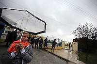 Pictured: A mother protesting stands outside the school gate of the Profitis Volvis primary school, Salonica, Greece. Monday 10 October 2016<br /> Re: Locals protesting against children of refugees attending school, have locked the gates of the primary school in Profitis Volvis on the outskirts of Thessaloniki in northern Greece. Police were present and the children were escorted through another gate.