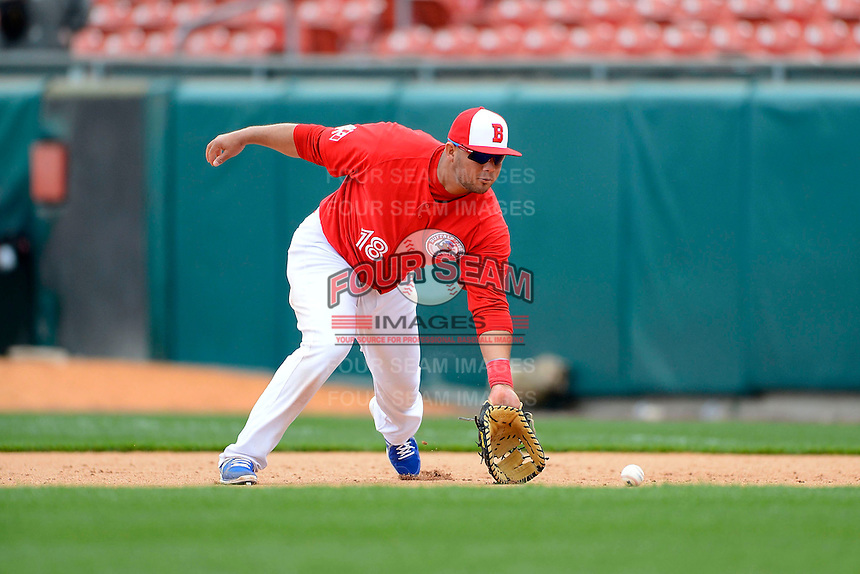 Buffalo Bisons first baseman Mauro Gomez #18 fields a ground ball during the second game of a doubleheader against the Pawtucket Red Sox on April 25, 2013 at Coca-Cola Field in Buffalo, New York.  Buffalo defeated Pawtucket 4-0.  (Mike Janes/Four Seam Images)