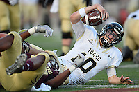 Idaho quarterback Matt Linehan (10) is tackled by Texas State defensive end Karee Berry (57) during first half of an NCAA Football game, Saturday, October 04, 2014 in San Marcos, Tex. Texas State leads Idaho 21-3 at the halftime(Mo Khursheed/TFV Media via AP Images)