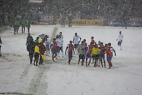 Members of the Costa Rica soccer team argue with referee Joel Aguilar of El Salvador to suspend play because of a heavy snowfall during the USA Men's National Team's World Cup Qualifier against Costa Rica  at Dick's Sporting Good Park in Commerce City, CO on March 22, 2013.