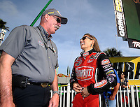 Mar 16, 2014; Gainesville, FL, USA; NHRA top fuel driver Leah Pritchett (right) talks with NHRA official announcer Alan Reinhart during the Gatornationals at Gainesville Raceway Mandatory Credit: Mark J. Rebilas-USA TODAY Sports