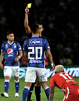 BOGOTÁ-COLOMBIA, 12-01-2020: Keiner Jiménez, árbitro muestra tarjeta amarilla a Oscar Barreto de Millonarios, durante partido entre Millonarios y América de Cali, por el Torneo ESPN 2020, jugado en el estadio Nemesio Camacho El Campin de la ciudad de Bogota. / Keiner Jimenez, referee shows yellow card to Oscar Barreto of Millonarios, during a match between Millonarios and America de Cali, for the ESPN Tournament 2020, played at the Nemesio Camacho El Campin stadium in the city of Bogota. Photo: VizzorImage / Luis Ramírez / Staff.