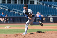 Scottsdale Scorpions starting pitcher J.B. Bukauskas (41), of the Houston Astros organization, follows through on his delivery during an Arizona Fall League game against the Peoria Javelinas at Peoria Sports Complex on October 18, 2018 in Peoria, Arizona. Scottsdale defeated Peoria 8-0. (Zachary Lucy/Four Seam Images)