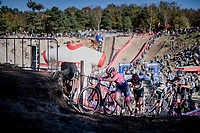 climbing out of the infamous Zonhoven 'Pit'<br /> <br /> Elite Women's Race<br /> 2021 UCI cyclo-cross World Cup - Zonhoven (BEL)<br /> <br /> ©kramon