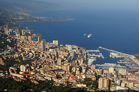 View on the Principality of Monaco, Mediterranean Sea. Monaco is the second smallest country in the world after Vatican City. To extend the country the ward of Fontvieille was reclaimed from the sea. Monte Carlo is the principal residential and resort area with the casino in the east and northeast. Monaco-Ville, the old city is on a rocky promontory known as Rock of Monaco. Fontvieille is a ward with one harbour and La Condamine is another ward with the second harbour: Port Nikolas Flores.