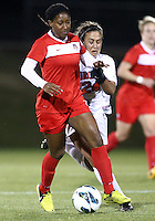 BOYDS, MARYLAND - April 06, 2013:  Tiffany McCarty (14) of The Washington Spirit moves in front of Danielle Colaprico (24) of the University of Virginia women's soccer team in a NWSL (National Women's Soccer League) pre season exhibition game at Maryland Soccerplex in Boyds, Maryland on April 06. Virginia won 6-3.