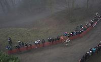 Gioele Bertolini (ITA/U23) running loney (& last) up a hill after crashing at the start of the Men's U23 race<br /> <br /> UCI Cyclocross World Cup Namur/Belgium 2016