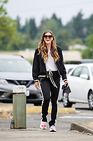 TACOMA, WA - JULY 31: Sofia Huerta #11 of the OL Reign arrives at the stadium before a game between Racing Louisville FC and OL Reign at Cheney Stadium on July 31, 2021 in Tacoma, Washington.