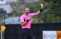 Referee Mark Rule brandishes a yellow card during the Central League football match between Miramar Rangers and Lower Hutt AFC at David Farrington Park in Wellington, New Zealand on Saturday, 10 April 2021. Photo: Dave Lintott / lintottphoto.co.nz