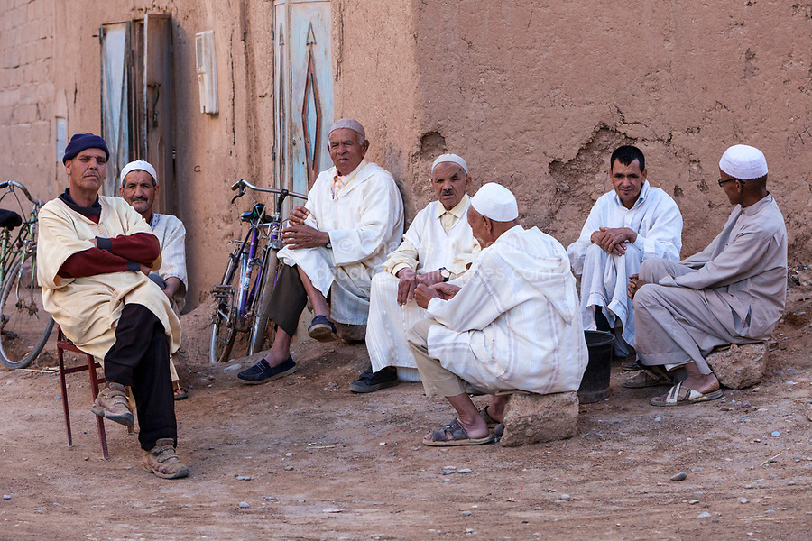 Elkhorbat, Morocco.  Berber Men Waiting for Prayer Time.