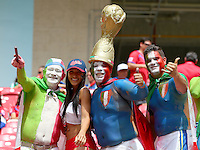 Italy fans pose for a photograph with a Costa Rica supporter